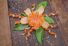 Orange radial peeled like a  flower Royalty Free Stock Photo