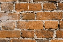 Orange ragged brick wall. Old red brick wall backgrounds. Close up