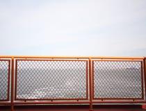 Orange railing Royalty Free Stock Image