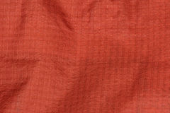 Orange Rain Coat Fabric Stock Images