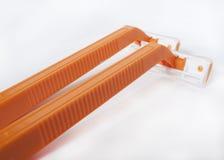 Orange rakknivar arkivfoto