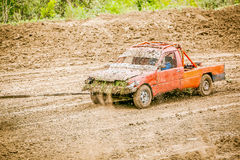 Orange rally car trailing Stock Image