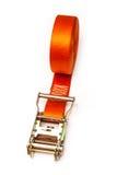Orange ratchet strap. Isolated on a white studio background stock photography