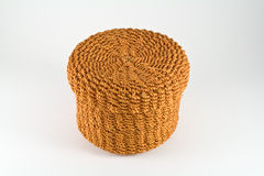 Orange rattan basket Stock Images