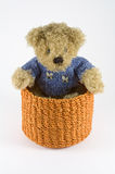 Orange rattan basket with puppet Stock Photo