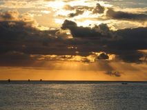 Orange Rays of light. Nearing sunset near a port in Mauritius. Colours unaltered Royalty Free Stock Images