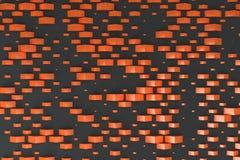 Orange rectangular shapes of random size on black background Stock Photos