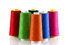Orange red blue green and pink bobbin Royalty Free Stock Images