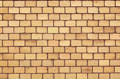 Orange red brick wall Stock Images