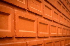 Orange red brick wall with vignette. Royalty Free Stock Images
