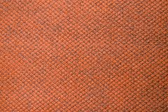 Orange colored fabric swatch samples texture unprinted suiting fabric from above .Cloth texture. Orange red colored fabric swatch samples texture royalty free stock images
