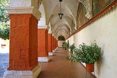 Orange Red Corridor Columns and Wall Fresco Paintings in the Monastery of Santa Catalina, Historical site in Arequipa, Peru