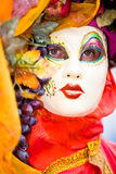 Orange and red costume in Venice Royalty Free Stock Image