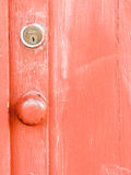 Orange Red Door with Lock Royalty Free Stock Photography