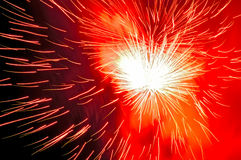Orange and red fireworks and red smoke. Stock Photography