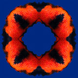 Orange red flame in the frame pattern  on the blue background Royalty Free Stock Photography