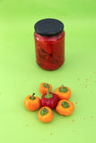 Orange and red hot chili pepper and pickled hot peppers Stock Photography