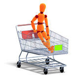 An orange red manikin sitting in a ahopping cart Stock Photography