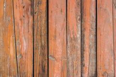 Orange red paint mottled wooden door Royalty Free Stock Photo