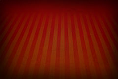 Orange red retro background with faded grunge borders and soft red and orange stripes sunburst effect or starburst design Stock Photography