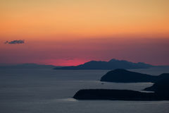 Orange and red sky and island on the coast of Dubrovnik Stock Photos