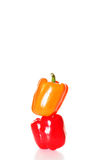 Orange and red stacked peppers tall Stock Photos