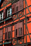 Orange red timber frame house royalty free stock images