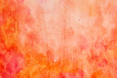 Orange red watercolor abstract. Handmade orange red abstract watercolor background painted on plain paper with a grainy look Stock Photo