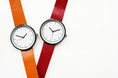 Orange and red wristwatches Stock Images