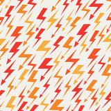 Orange, red and yellow lightnings seamless pattern Stock Photography