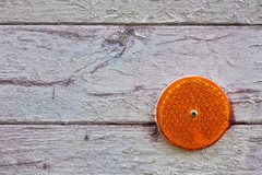 Orange reflex reflector Stock Image