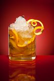 Orange refreshment drink. With ice on red background Stock Image