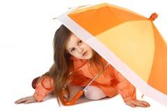 Orange Regenschirm stockfotografie