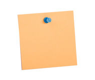 Orange  reminder note with blue pin Royalty Free Stock Image