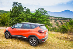 Orange Renault Kaptur car stock images