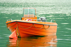 Orange rescue boat on the water Stock Image