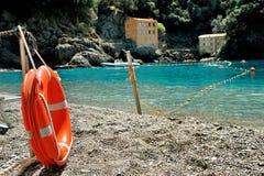 Orange rescue circle at the sea beach Royalty Free Stock Photos