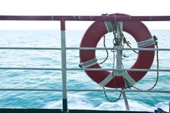 Orange rescue lifebelt of the boat Stock Image