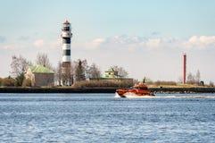 Orange rescue tug entering port of Riga town in Latvia Stock Photography