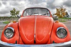 Orange retro car Stock Images