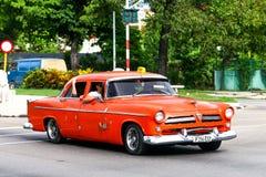 Orange retro motor car Stock Photo