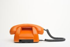 Orange retro phone. This phone is like new and in realy good focus with a little larger depth of field. Shiftable to lots of deep colors Royalty Free Stock Image