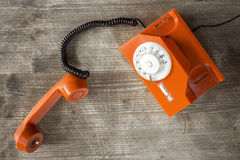 Orange retro phone-top view Royalty Free Stock Image