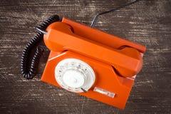 Orange retro phone. Top view. Royalty Free Stock Photos