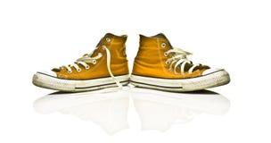 Orange retro sneakers. Isolated on white royalty free stock photography