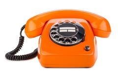 Orange retro telefon royaltyfria foton