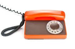 Orange retro telephone Stock Images