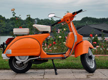 Orange retro vespa Stock Photo