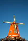 Orange retro windmill Stock Photos