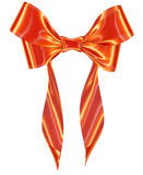 Orange ribbon bow on white background Royalty Free Stock Photography